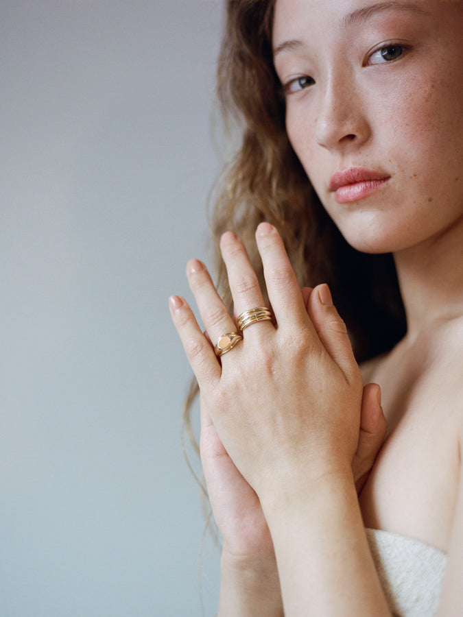 Model wearing J. Hannah Strata Signet and Quarry Ring 14k Gold