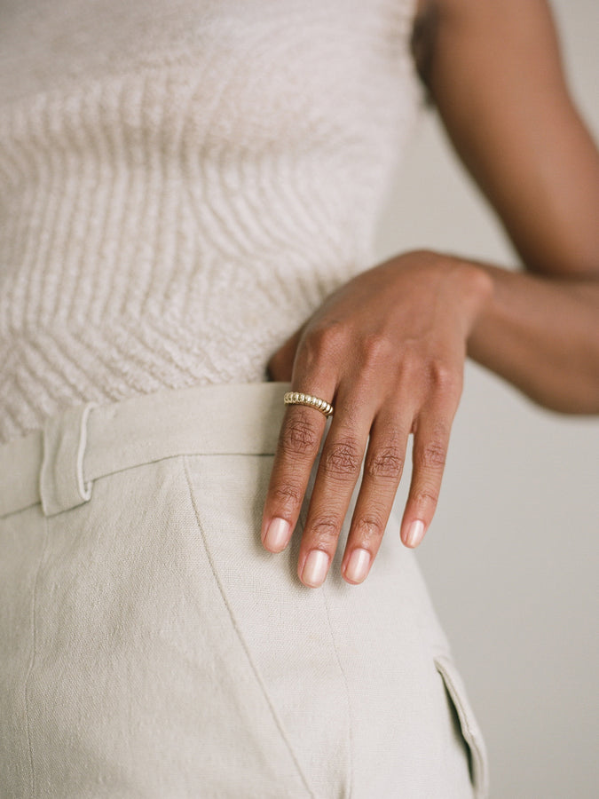 Model wearing J. Hannah Niche Ring 14k Gold