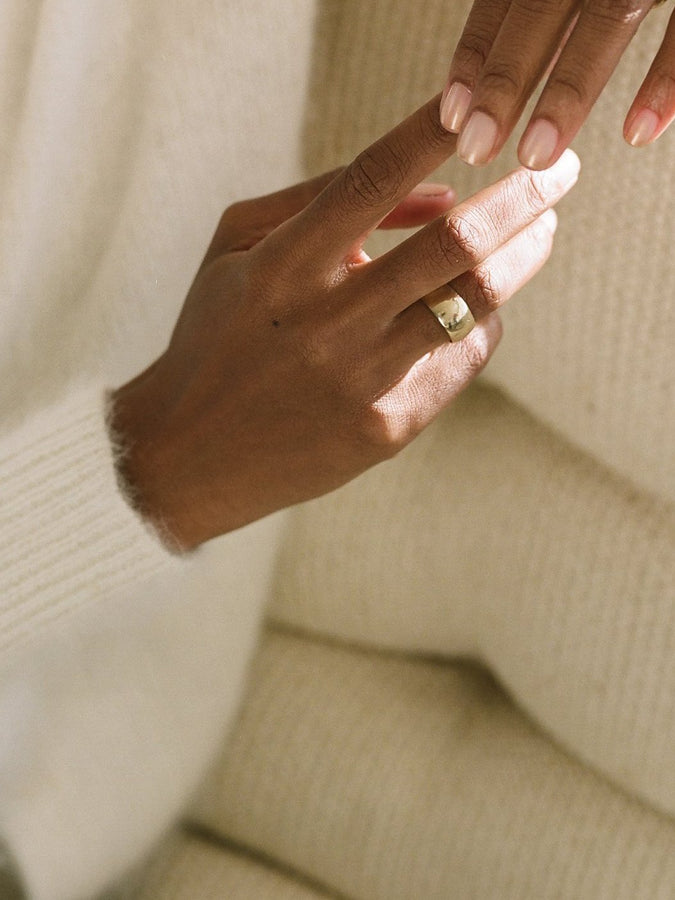 Hand wearing J. Hannah Classic Cigar Band Ring in 14k Gold