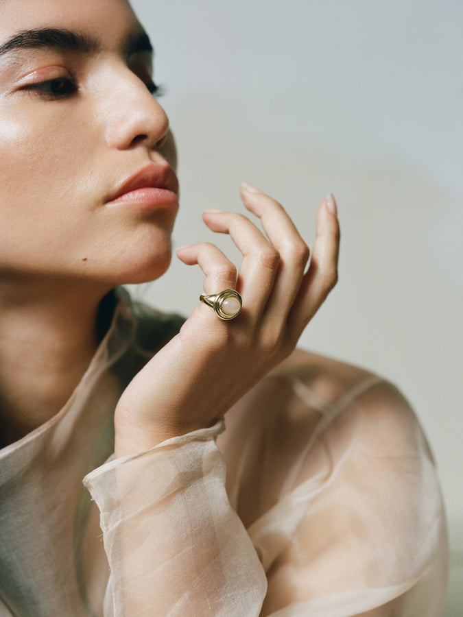 Model wearing J. Hannah Duet Cocktail Ring Peach Moonstone 14k Gold on pinky.