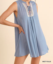 Sleeveless Ruffled Tunic with Criss Cross String Detail