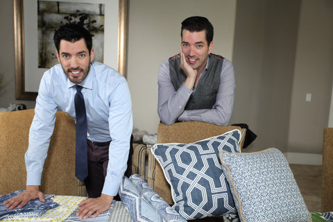 jonathan and drew scott standing over their fabric line