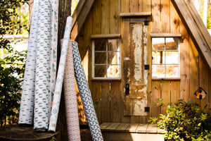 picture of alpaca, mountain, pine tree, and western styled fabrics with rustic cabin outdoors