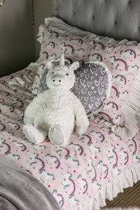 picture of pink unicorn fabric on girls bed