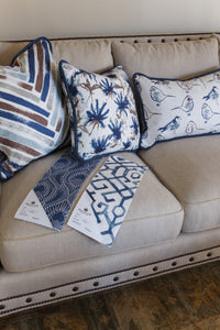 photo of Chinese inspired fabric pillows on couch