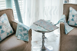 Photo of nautical themed lobster fabric laying on chair arm