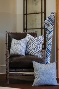 photo of chinese inspired fabrics sitting on vintage leather chair
