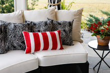 picture of a red striped fabric on a outdoor pillow