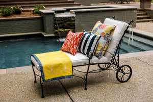 picture of outdoor flower bloom fabric sitting on lounge chair next to pool