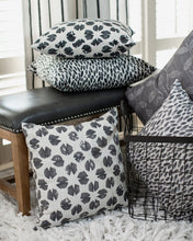 photo of classic styled fabrics sitting on leather vintage bench