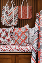 photo of chinese fabrics on pillows on a bench in a modern mud room