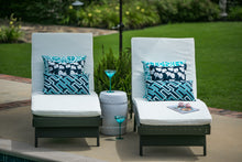picture of blue and white outdoor beach nautical fabrics sitting on lounge chair by a pool backyard