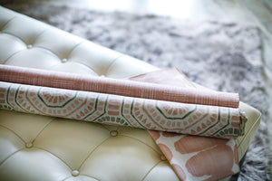 photo of pink fabric lying on a leather bench in a modern decor room