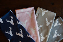 picture of deer heads antlers on pink fabric cabin rustic decor