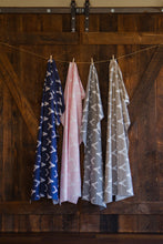 photo of deer fabrics hanging on farm wooden barn door