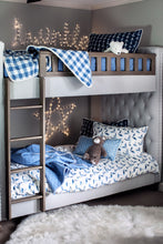 picture of children's nautical themed fabric in a child's bedroom with sailboats and ship anchors plaid