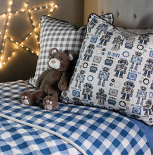 photo of robots printed on fabric for bedding in kid's room blue plaid fabric