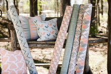 picture of mid west cabin inspired fabrics sitting on old wooden log bench