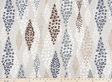 Photo of blue, brown, beige, and white repeating diamond pattern on tan colored fabric