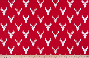 picture of repeating deer head antler pattern printed on cotton fabric.