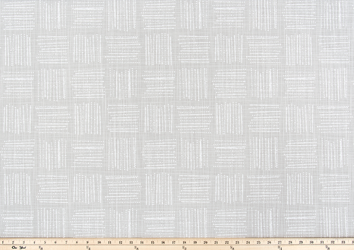 Photo of grey fabric with a square geometric pattern
