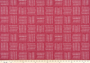 Photo of pink fabric with a square geometric pattern