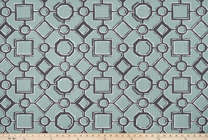 picture of green, black, and white Brazilian pattern inspired fabric