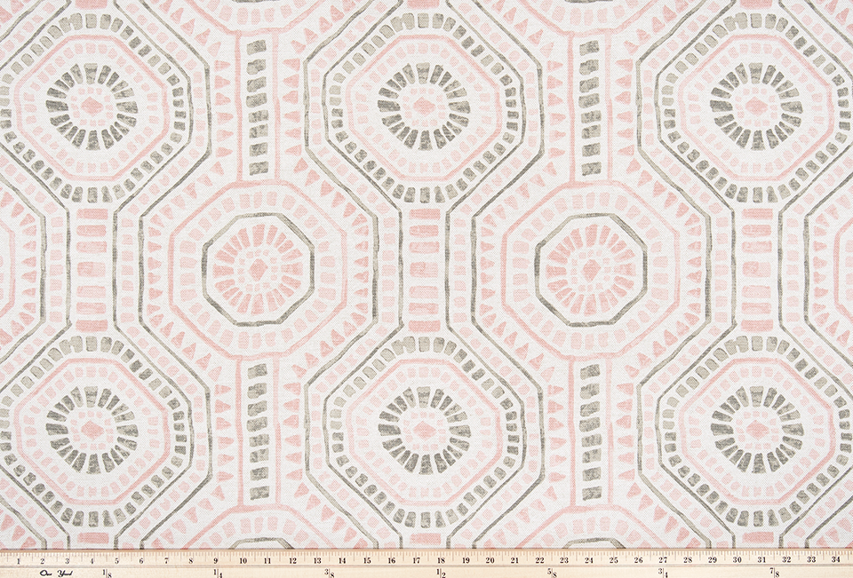 picture of repeating tribal Indian octagon repeating pattern on pink fabric