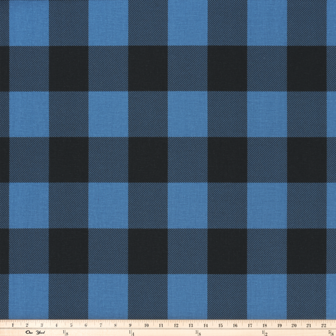 photo of black buffalo plaid check pattern printed on blue fabric