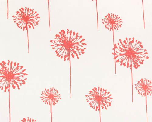 coral colored dandelion flower printed on white fabric