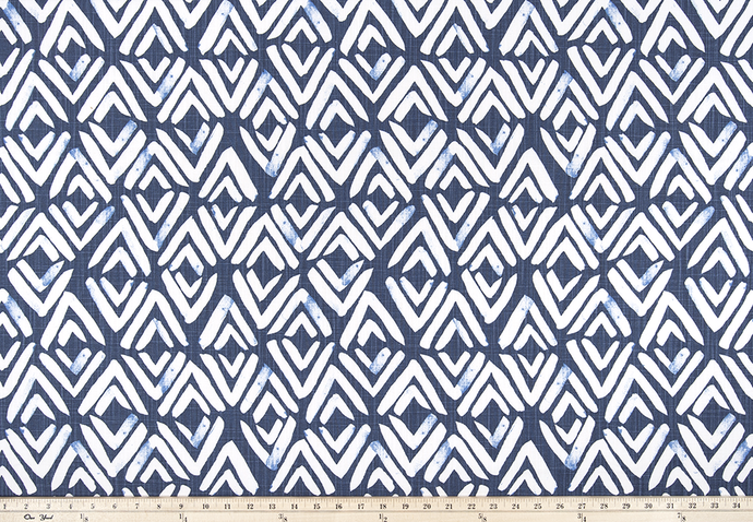 photo of white diamond pattern on blue fabric