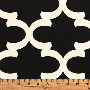 Photo of black Quatrefoil trellis pattern printed on white fabric