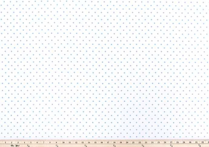photo of polka dot pattern printed on white cotton fabric.