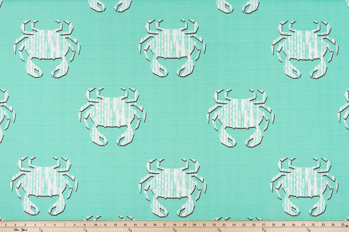 photo of repeating geometric crab pattern fabric perfect for the beach in summertime