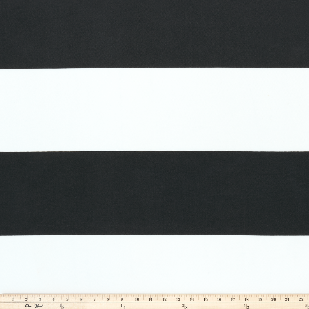 Photo of black stripes printed on white fabric outdoor fabric beach fabric pool fabric