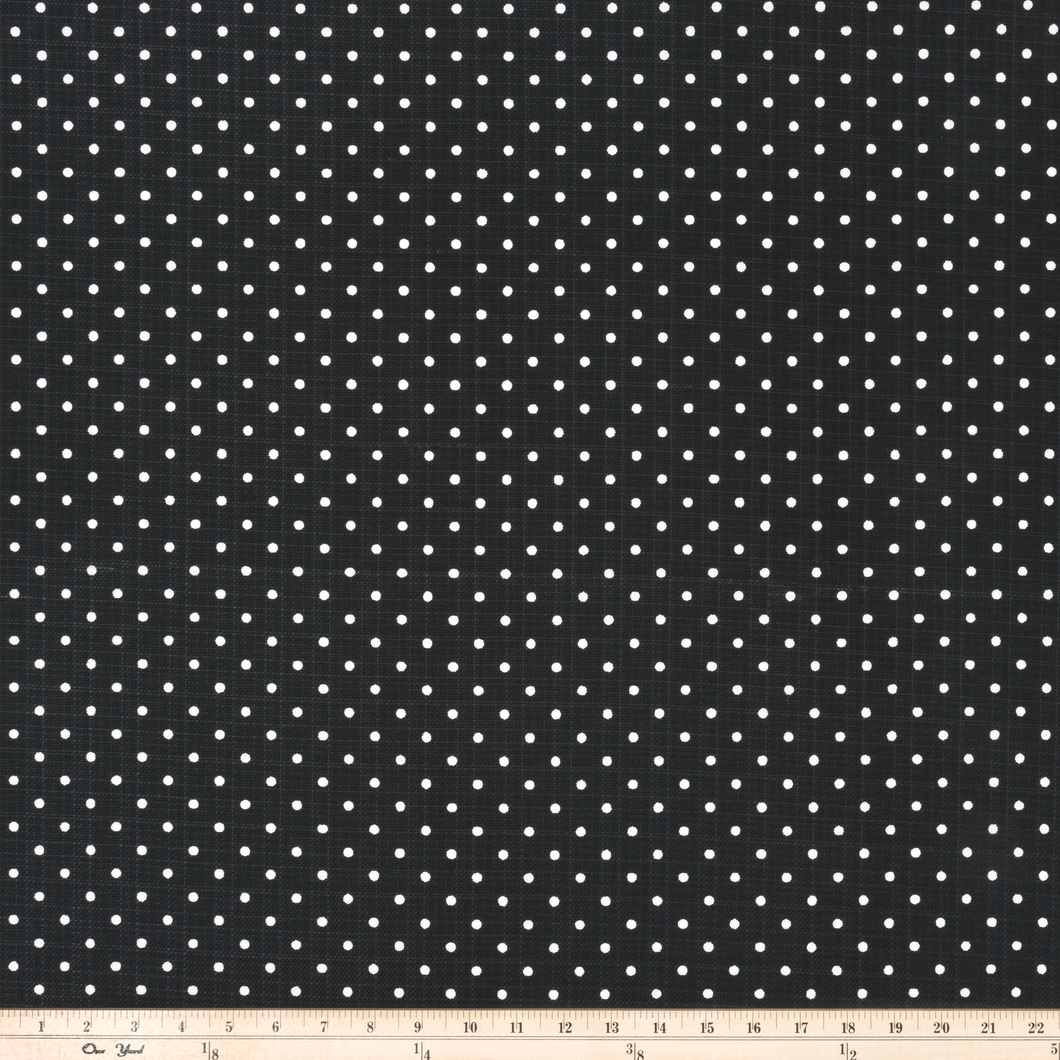 photo of white polka dots on black outdoor fabric