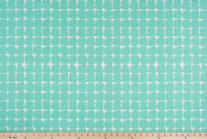 photo of repeating square geometric pattern printed fabric perfect for the beach