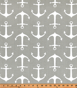Photo of repeating ship anchor pattern on grey fabric