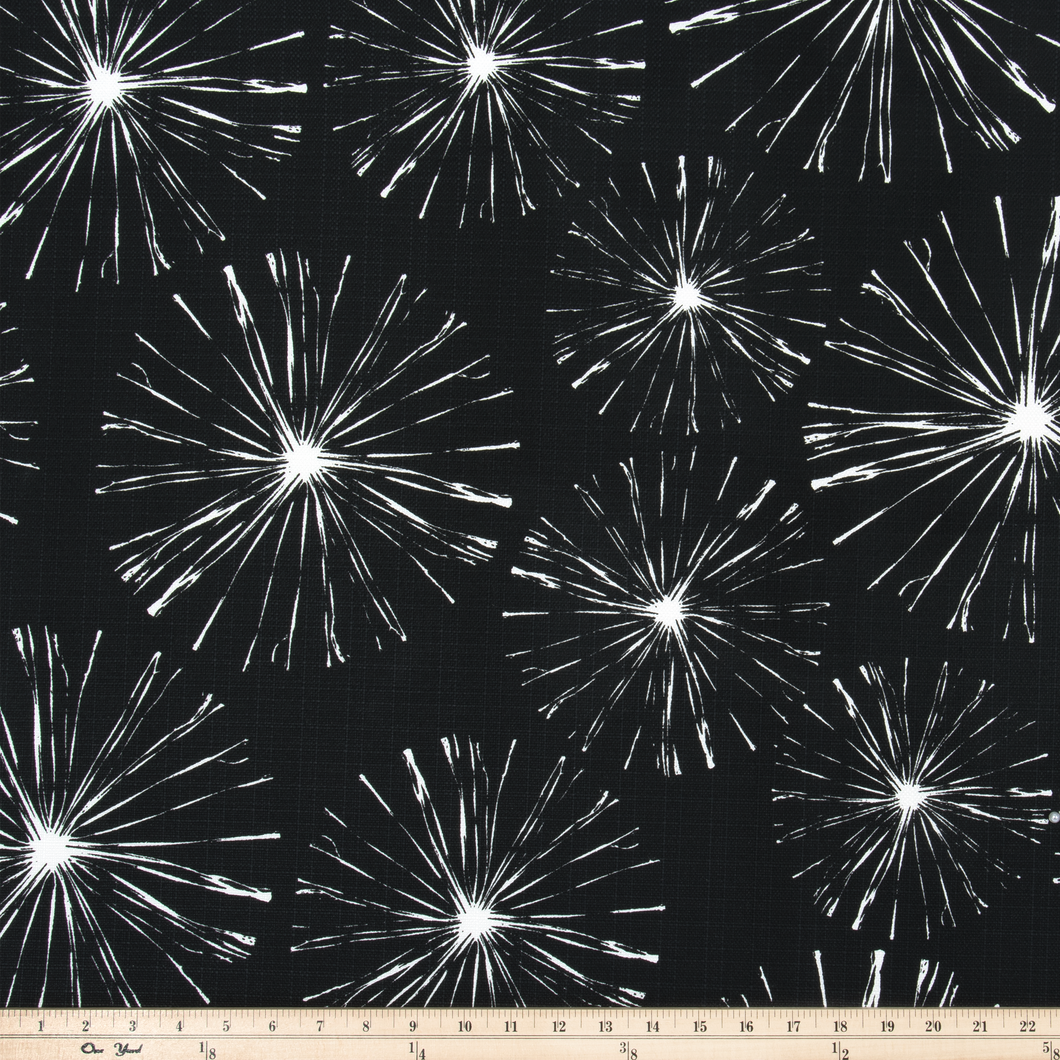 picture of white sparks fireworks printed on black outdoor fabric