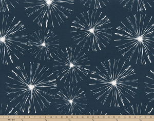 photo of white starburst firework pattern printed on blue fabric sparkle flare