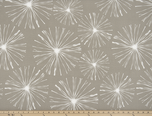photo of white starburst firework pattern printed on beige fabric sparkle flare