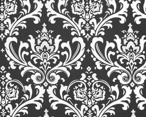 Photo of repeating white Damask pattern printed on black fabric