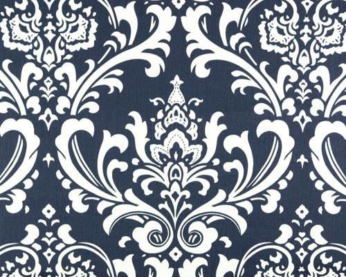 Photo of repeating white Damask pattern printed on blue fabric
