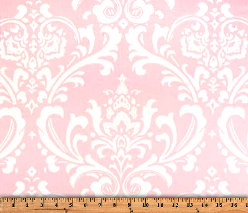 Photo of repeating white Damask pattern printed on pink fabric