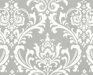Photo of repeating white Damask pattern printed on grey fabric
