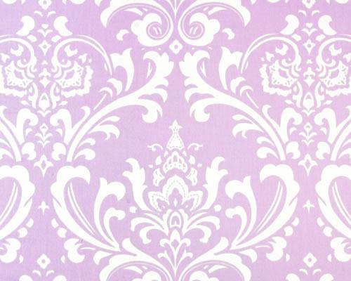 Photo of repeating white Damask pattern printed on purple fabric