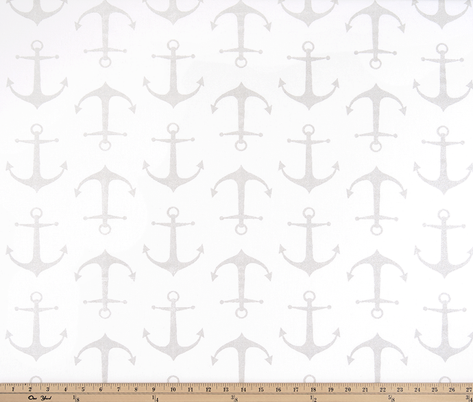 Photo of repeating grey ship anchor pattern on white fabric