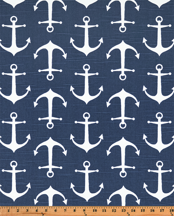 Photo of white repeating ship anchor pattern on blue fabric