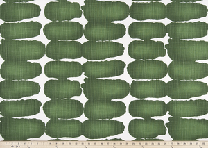 picture of green shibori dot fabric with ruler