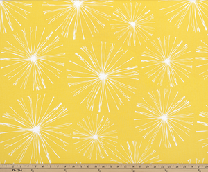 photo of white starburst firework pattern printed on yellow fabric sparkle flare